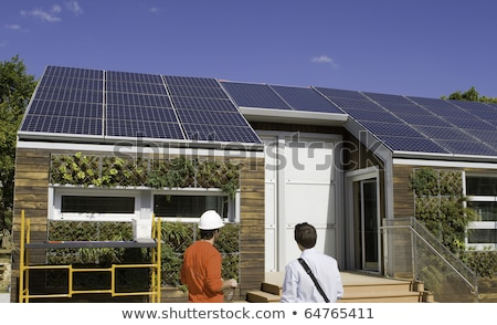 Workers Standing In Front Of House With Solar Panels Stock photo © AndreyPopov