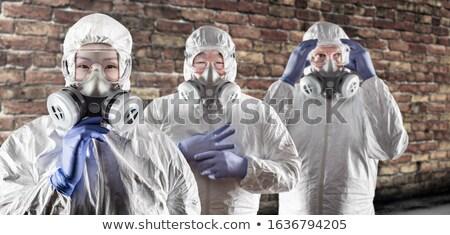 Chinese kaukasisch vrouw mannen gas maskers Stockfoto © feverpitch