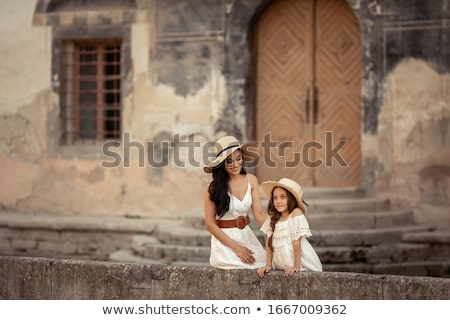 Young beautiful mother of eastern appearance walks with her daughter on the ancient streets of the M Stock photo © ElenaBatkova