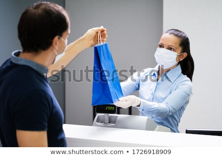 Cashier In Retail Shop Or Store At Counter Stock photo © AndreyPopov