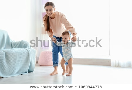 happy baby learning to walk with mother help Stock photo © dolgachov