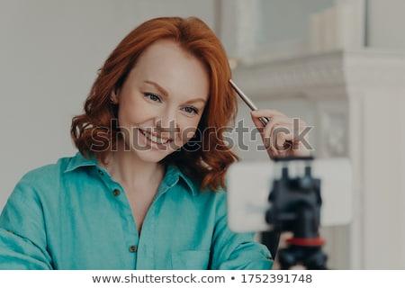 Közelkép lövés boldog vörös hajú nő nő lemezek Stock fotó © vkstudio