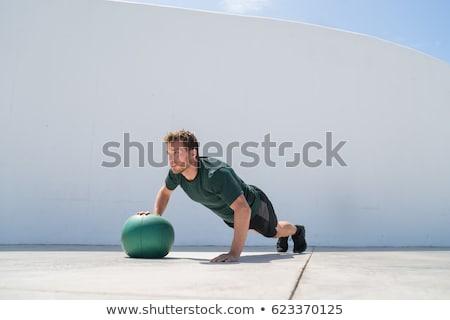 Fitness człowiek trening siłowy muzyka piłka piersi Zdjęcia stock © Maridav