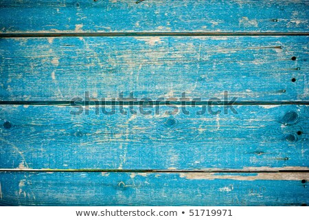 Blue flaky paint on a wooden fence. Stock photo © latent