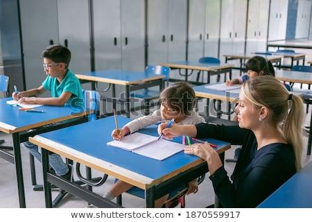 Maestro ayudar escuela primaria tareas mujer Foto stock © HASLOO
