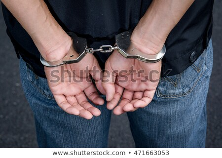 Hands handcuffed Stock photo © AndreyKr