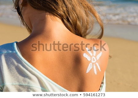 Woman on the beach with suncream Stock photo © photography33