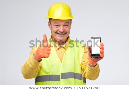 Foreman with mobile phone, studio shot Stock photo © photography33