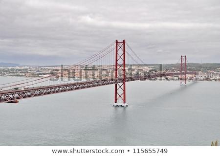 Hagyományos híd folyó Lisszabon Portugália égbolt Stock fotó © inaquim
