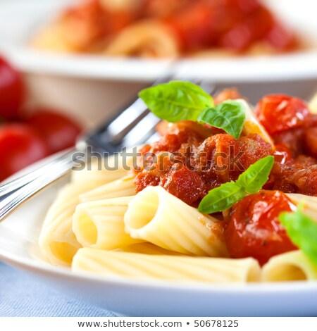 Pasta with tomatoes and pancetta Stock photo © ozaiachin