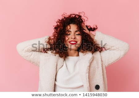 young and beautiful woman, with curly hair, with a winter coat, on white background, studio shot Stock photo © alexandrenunes