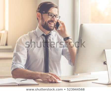business man with glasses talking on phone stock photo © feedough