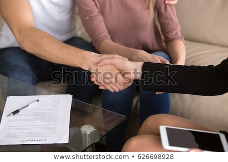 Close up of a man shaking hand to a woman in a dealership Stock photo © wavebreak_media