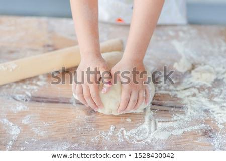 child rolling out dough stock photo © gewoldi