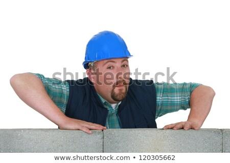 Bearded mason stood by unfinished wall Stock photo © photography33