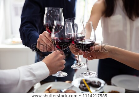 Woman cheering up with red wine Stock photo © Witthaya