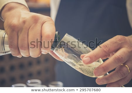 Stock photo: People with champagner in a bar