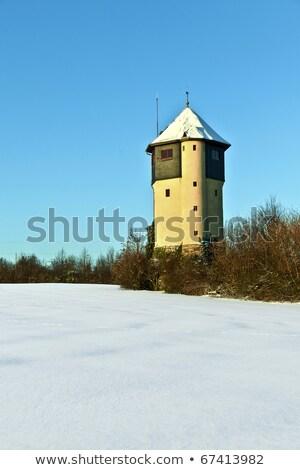 watertower in  snow covered fields Stock photo © meinzahn