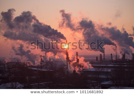 industry landscape in sunrise with smoking chimneys Stock photo © meinzahn