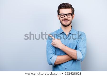 молодые · человека · указывая · далеко · красивый - Сток-фото © stockyimages
