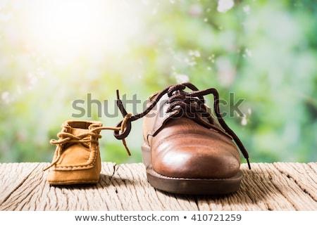 pequeno · bebê · menino · grande · sapatos · isolado - foto stock © ewastudio