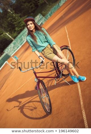 девушки Постоянный пурпурный велосипедов теннисный корт Сток-фото © vlad_star