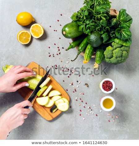 Stock photo: Woman eating raw yellow pepper, top view