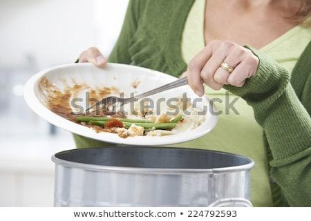Nő étel maradék szemét tároló nők Stock fotó © HighwayStarz