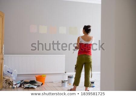 Mulher jovem pintar branco mulher Foto stock © wavebreak_media