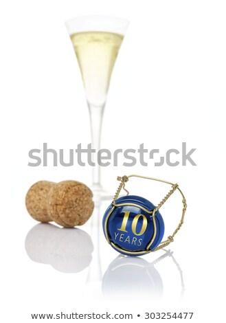 Champagne cap 10 anni compleanno numeri Foto d'archivio © Zerbor