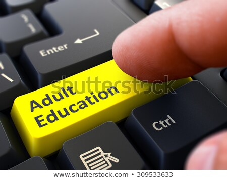 Finger Presses Yellow Keyboard Button Adult Education. Stock photo © tashatuvango