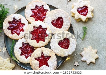 Lekvár kekszek porcukor gyümölcs piros tányér Stock fotó © Digifoodstock