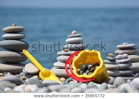Yellow children's bucket with  scoop on seacoast Stock photo © Paha_L