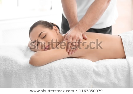 attractive woman receiving back massage at spa center stock photo © wavebreak_media