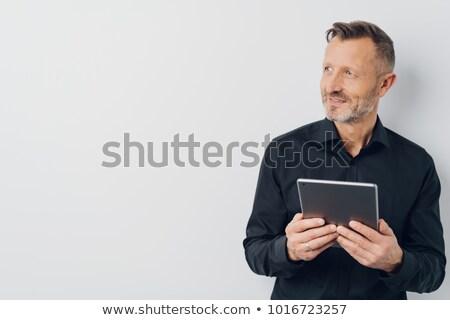 dojrzały · mężczyzna · siwe · włosy · patrząc · touchpad · Widok · techniczne - zdjęcia stock © zurijeta