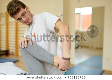 terapeuta · paziente · lavoro · colonna · vertebrale · flessibilità - foto d'archivio © mady70