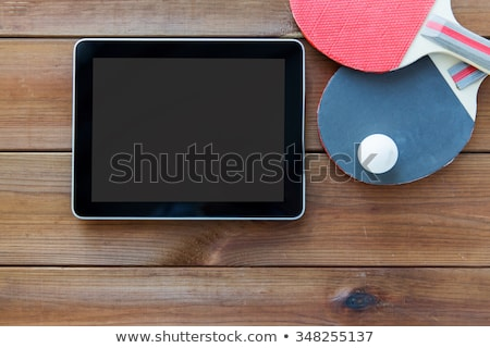 close up of tennis racket with ball and tablet pc Stock photo © dolgachov