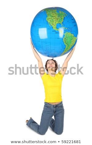 Mulher olhando inflável globo feminino camisas Foto stock © IS2