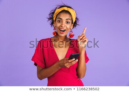Portrait of a smiling young african woman in headband Stock photo © deandrobot