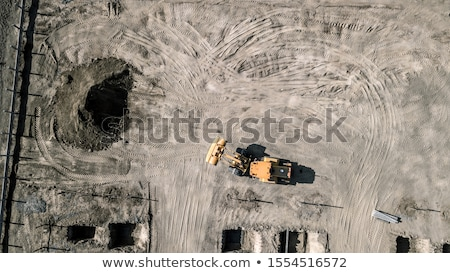 Working Excavator Tractor Digging A Trench At Construction Site Stock photo © feverpitch