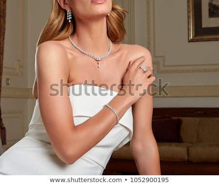 Beautiful girl diamantes brincos posando branco Foto stock © NeonShot