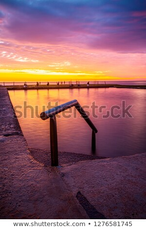 Vivid sunrise views across Mona Vale Rock Pool Stock photo © lovleah
