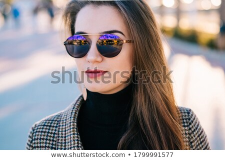 Close up portrait of a pretty young woman wearing beret Stock photo © deandrobot