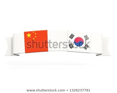 Banner due piazza bandiere Cina Corea del Sud Foto d'archivio © MikhailMishchenko