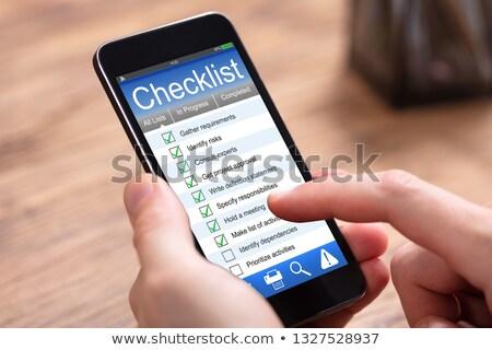 Személy tömés lista űrlap mobiltelefon fából készült Stock fotó © AndreyPopov