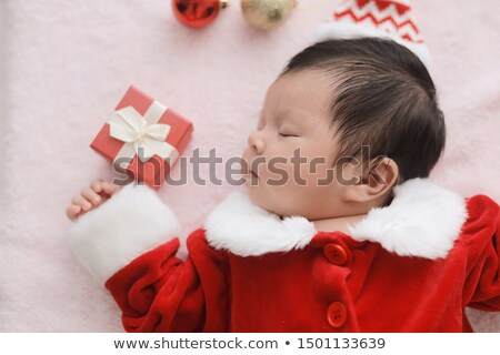 happy family with gift and baby boy at home stock photo © dolgachov