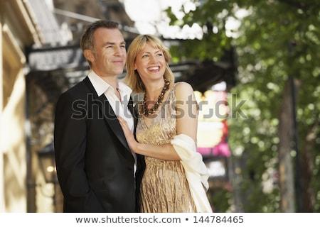 Alegre casal em pé isolado vermelho Foto stock © deandrobot