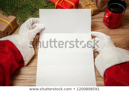 merry christmas santa claus read wish list gifts stock photo © robuart