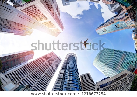 Airplane flying over city skyscrapers. Plane in the sky city scape skyline background banner. Flat v Stock photo © makyzz