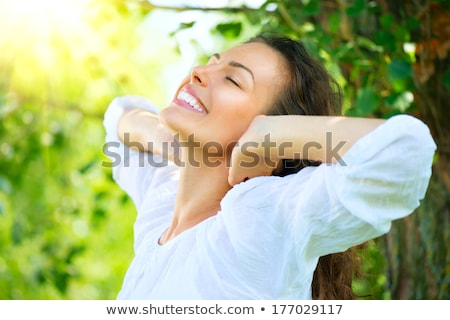 Woman Outdoors in Park on Sunny Day Stock photo © artfotodima